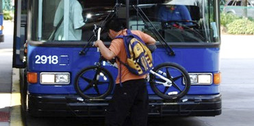 Cyclist loading Bike on Bus