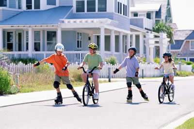 Children on rollerblades and bicycles