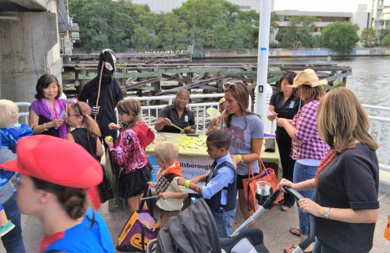 Kids gobble up nearly 4,000 #VisionZero safety bands at first Riverwalk Trick or Treat event!
