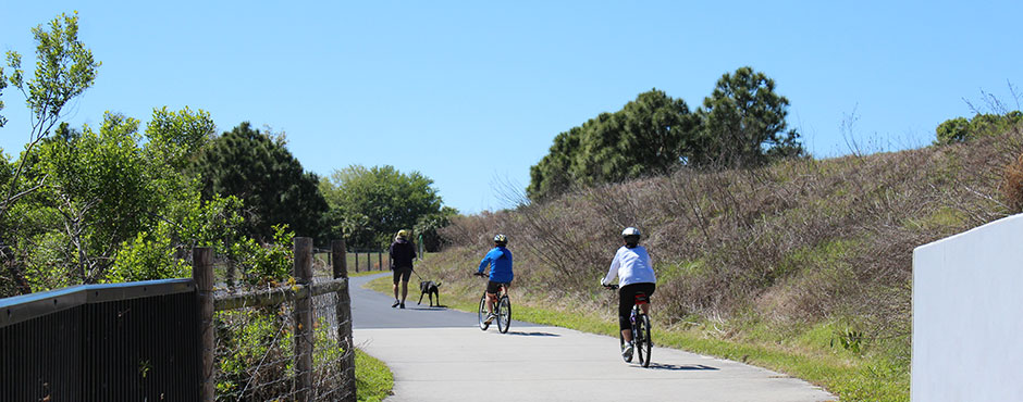 people walking and biking on a trail