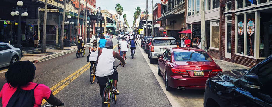 bicyclists from the All Love cycling group biking through Ybor City