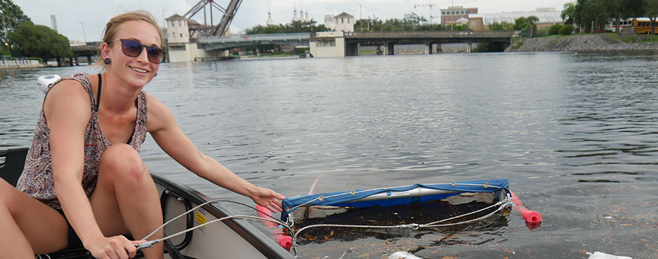 Charlotte Haberstroh studying plastics in Hillsborough River