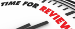 close up of a clock face with the hands pointing to the word review