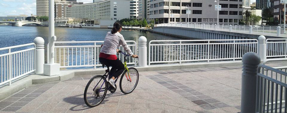 biker on the Hillsborough River Walk