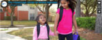 two girls walking with backpacks