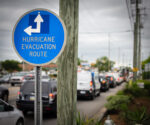 Hurricane Evacuation Route sign with Traffic