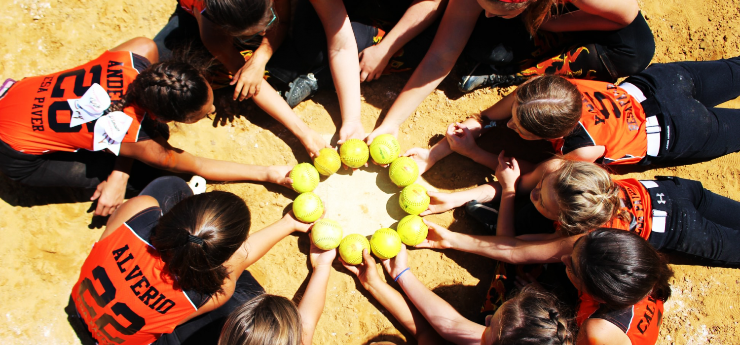 Softball players in a circle